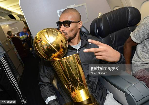 Leandro Barbosa of the Golden State Warriors kisses the NBA trophy on the plane as the team travels home from Cleveland after winning the 2015 NBA...