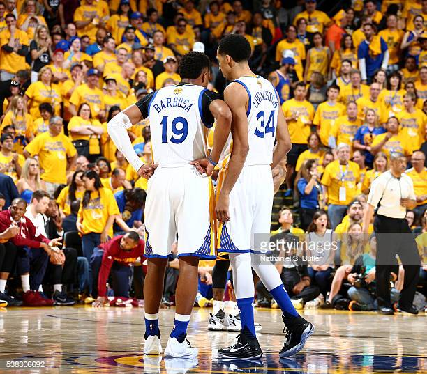Leandro Barbosa of the Golden State Warriors talks with Shaun Livingston during the game against the Cleveland Cavaliers in Game Two of the 2016 NBA...