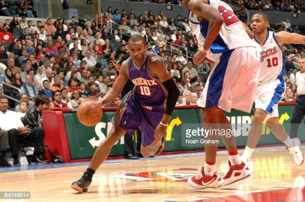 Leandro Barbosa of the Phoenix Suns dribbles the ball against Marcus Camby of the Los Angeles Clippers at Staples Center on January 11 2009 in Los...