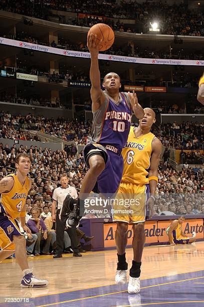 Leandro Barbosa of the Phoenix Suns goes strong to the hoop against Maurice Evans and Luke Walton of the Los Angeles Lakers on October 31 2006 at...