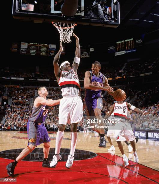 Leandro Barbosa of the Phoenix Suns goes to the basket against Zach Randolph of the Portland Trail Blazers during the game at the Rose Garden on...