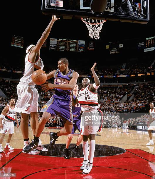 Leandro Barbosa of the Phoenix Suns goes to the basket against Zach Randolph and Rasheed Wallace of the Portland Trail Blazers during the game at the...