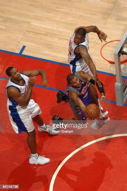 Leandro Barbosa of the Phoenix Suns goes up for a shot against Fred Jones and DeAndre Jordan of the Los Angeles Clippers at Staples Center on January...