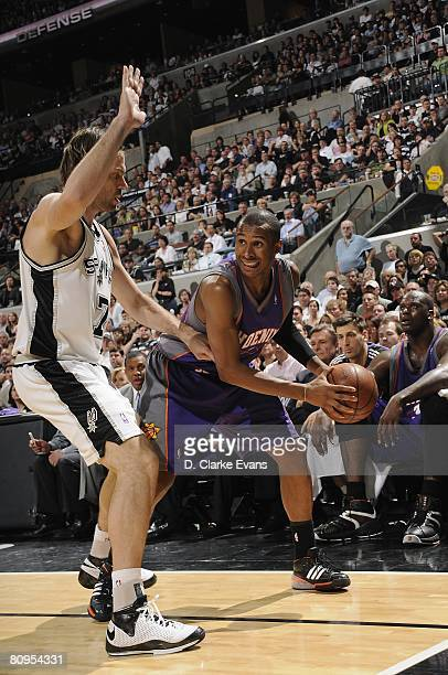 Leandro Barbosa of the Phoenix Suns looks to move the ball against Fabricio Oberto of the San Antonio Spurs in Game Five of the Western Conference...