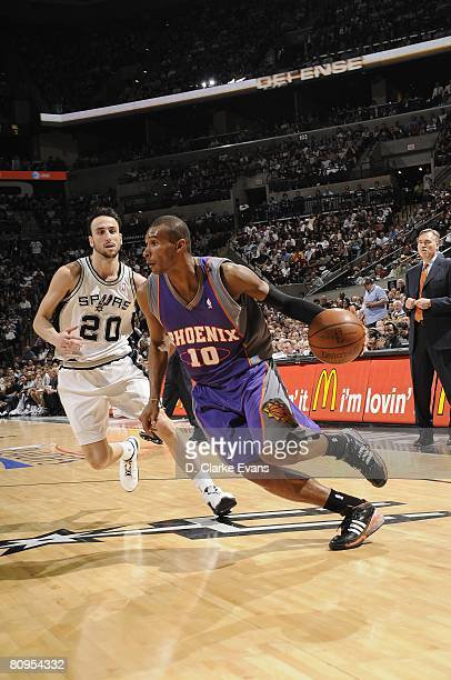 Leandro Barbosa of the Phoenix Suns moves the ball past Manu Ginobili of the San Antonio Spurs in Game Five of the Western Conference Quarterfinals...