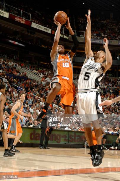 Leandro Barbosa of the Phoenix Suns puts a shot up over Ime Udoka of the San Antonio Spurs at US Airways Center on March 9 2008 in Phoenix Arizona...