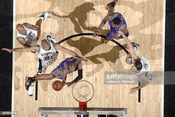 Leandro Barbosa of the Phoenix Suns shoots a layup against Tim Duncan Bruce Bowen and Fabricio Oberto of the San Antonio Spurs in Game Five of the...