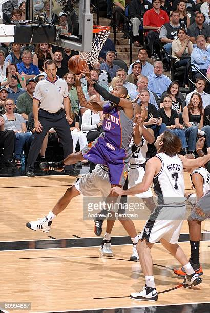 Leandro Barbosa of the Phoenix Suns shoots a layup against Tim Duncan and Fabricio Oberto of the San Antonio Spurs in Game Five of the Western...