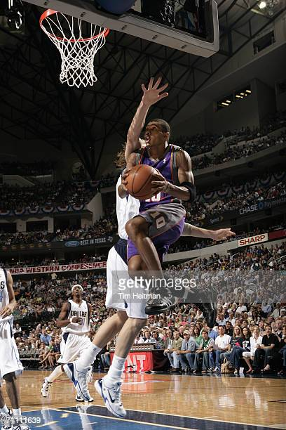 Leandro Barbosa of the Phoenix Suns takes the ball to the basket against Dirk Nowitzki of the Dallas Mavericks in game two of the Western Conference...