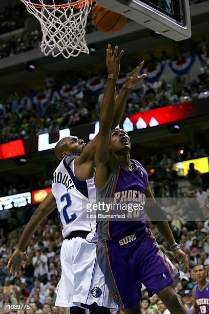 Leandro Barbosa of the Phoenix Suns tosses up a shot under pressure from Jerry Stackhouse of the Dallas Mavericks in game one of the Western...