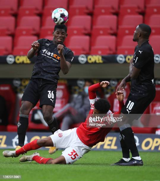 Leandro Barreiro of Mainz is challenged by Breel Embolo and Marcus Thuram of Moenchengladbach during the Bundesliga match between 1 FSV Mainz 05 and...