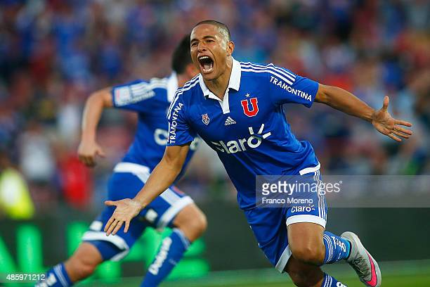 Leandro Benegas of Universidad de Chile celebrates after scoring the fourth goal of his team during a match between U de Chile and Palestino as part...
