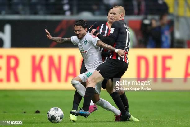 Leandro Bittencourt of SV Werder Bremen battles for possession with Sebastian Rode of Eintracht Frankfurt during the Bundesliga match between...
