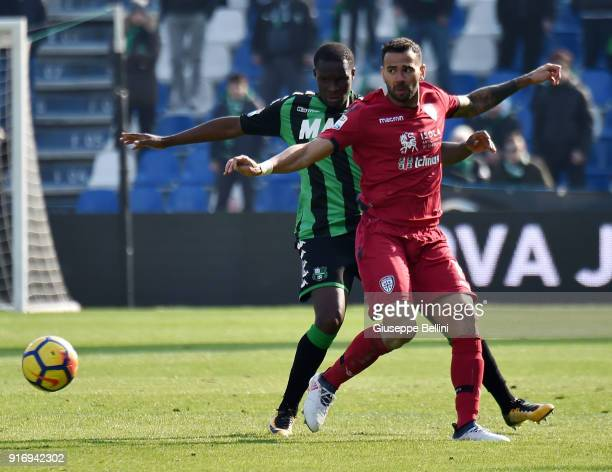 Leandro Castan of Cagliari Calcio and Khouma Babacar of US Sassuolo in action during the serie A match between US Sassuolo and Cagliari Calcio at...
