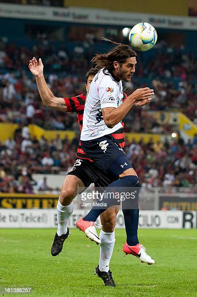 Leandro Cufre of Atlas struggles for the ball with Joaquin Larrivery of Atlante during the match as part of the Clausura 2013 Liga MX at Estadio...