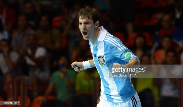 Leandro Cuzzolino of Argentina celebrates after scoring his teams first goal during the FIFA Futsal World Cup Round of 16 match between Serbia and...