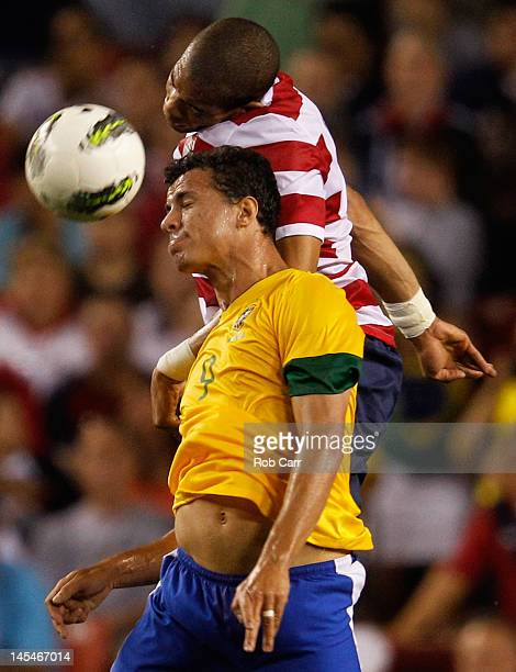 Leandro Damiao of Brazil and Oguchi Onyewu of USA head the ball during an International friendly game at FedExField on May 30 2012 in Landover...