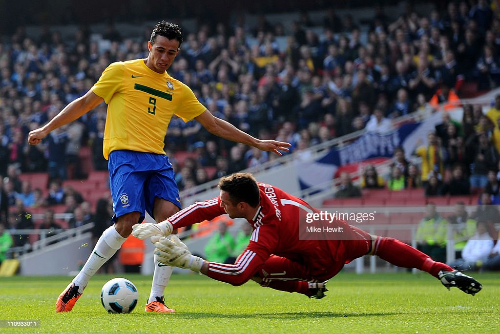 Leandro Damiao of Brazil has his effort stopped by Allan McGregor of Scotland during the International friendly match between Brazil and Scotland at Emirates Stadium on March 27, 2011 in London, England.