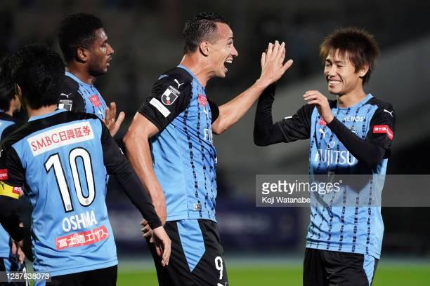 Leandro Damiao of Kawasaki Fronale celebrates his side's second goal with team mate during the J.League Meiji Yasuda J1 match between Kawasaki...