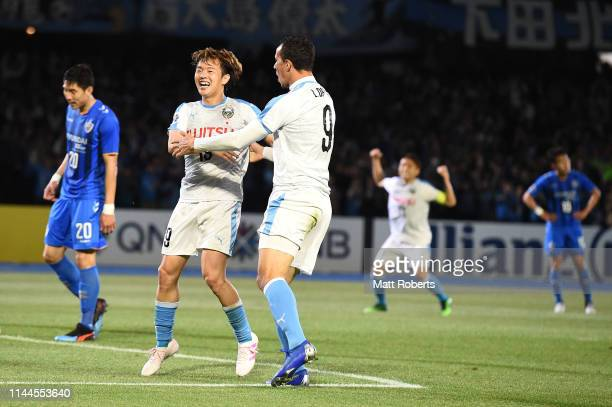Leandro Damiao of Kawasaki Frontale celebrates scoring a goal with Manabu Saito during the AFC Champions League Group H match Kawasaki Frontale and...