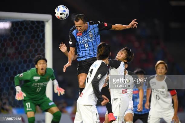 Leandro Damiao of Kawasaki Frontale heads the ball to score his side's third goal during the J.League Meiji Yasuda J1 match between Kawasaki Frontale...