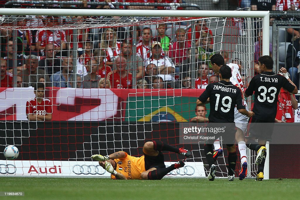 Leandro Damiao(2nd R) of Porto Alege scores the first goal against Christian Abbiati (L), Gianluca Zambrotta (2nd L)Thiago SilvaThiago Silva (R) of Milan during the Audi Cup third place match between AC Milan and International De Porto Alegre at Allianz Arena on July 27, 2011 in Munich, Germany.