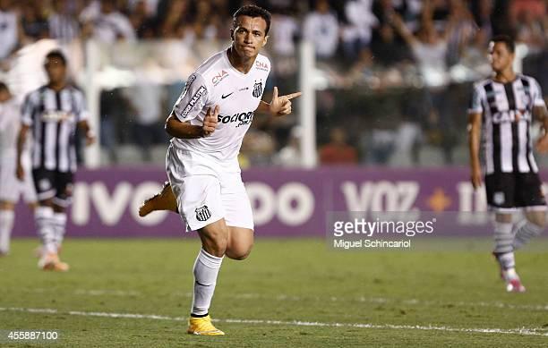 Leandro Damiao of Santos celebrates his goal scored during a match between Santos and Figueirense of Brasileirao Series A 2014 at Vila Belmiro...
