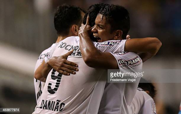 Leandro Damiao of Santos celebrates scoring the first goal with David Braz during the match between Santos and Atletico PR for the Brazilian Series A...
