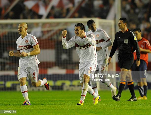Leandro Damilao of Internacional celebrates a scored goal with teammate during a match against Independiente as part of the 2011 Recopa Sudamericana...