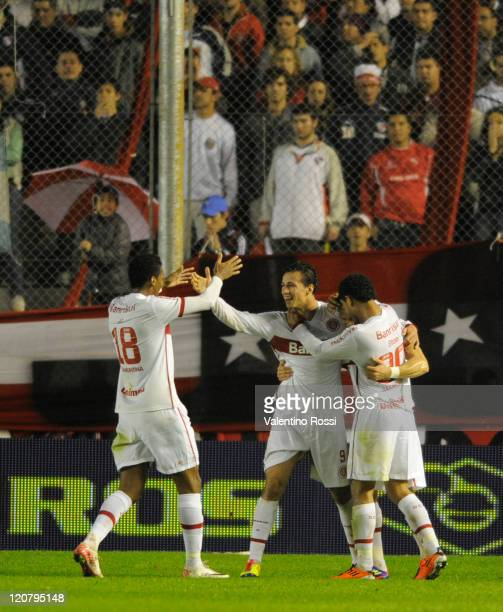 Leandro Damilao of Internacional celebrates a scored goal with teammate Jo end Elton during a match against Independiente as part of the 2011 Recopa...