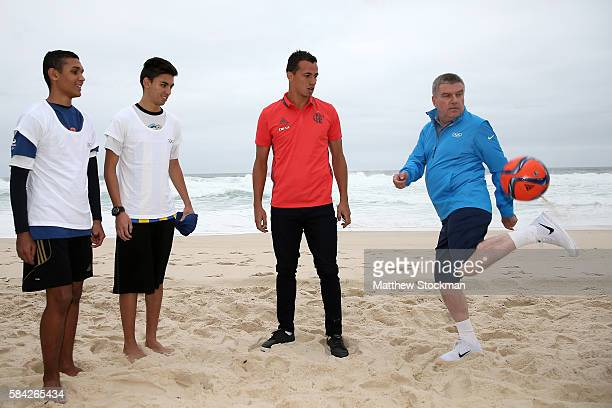 Leandro Damião of the Flamengo football cub and IOC President Thomas Bach meet local youth for football practice on the beach in the Barra da Tijuca...