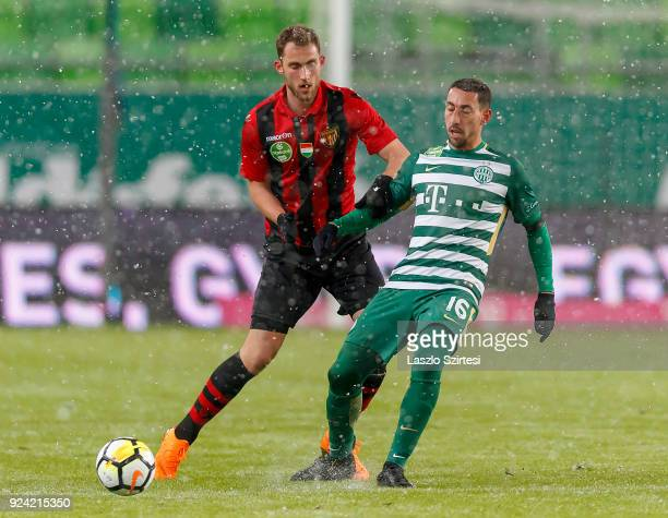 Leandro De Almeida 'Leo' #16 of Ferencvarosi TC competes for the ball with Marton Eppel of Budapest Honved during the Hungarian OTP Bank Liga match...