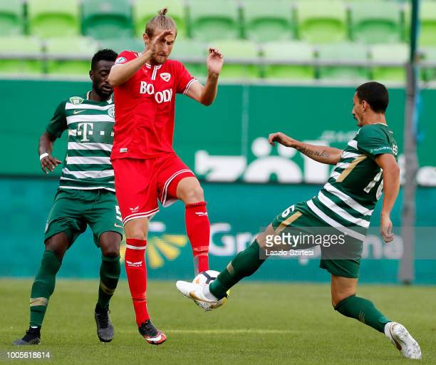 Abraham Frimpong of Ferencvarosi TC slide tackles Nikolaos Ioannidis of DVTK during the Hungarian OTP Bank Liga match between Ferencvarosi TC and...