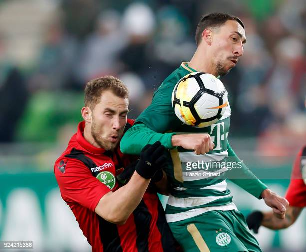 Leandro De Almeida 'Leo' of Ferencvarosi TC fights for the ball with Marton Eppel of Budapest Honved during the Hungarian OTP Bank Liga match between...