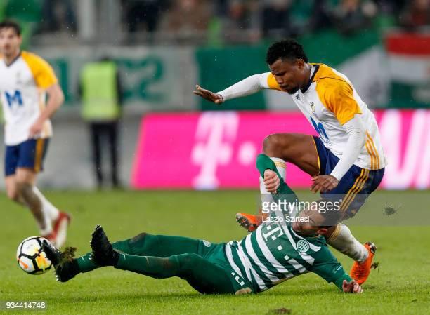 Leandro De Almeida 'Leo' of Ferencvarosi TC fights for the ball with Ezekiel Henty of Puskas Akademia FC during the Hungarian OTP Bank Liga match...