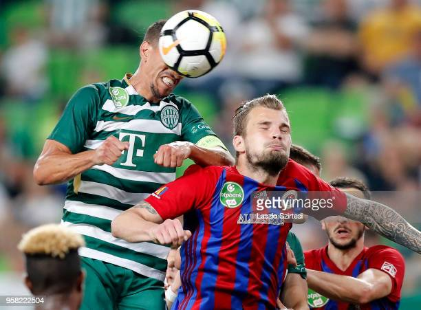 Leandro De Almeida 'Leo' of Ferencvarosi TC wins the ball from Vit Benes of Vasas FC during the Hungarian OTP Bank Liga match between Ferencvarosi TC...