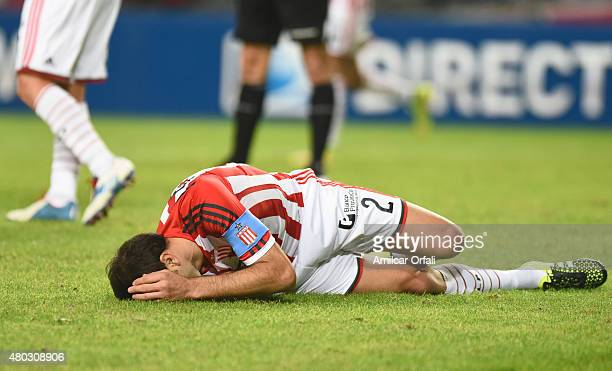 Leandro Desabato of Estudiantes de la Plata lies on the grass after being fouled during a match between Estudiantes and San Martin as part of 16th...