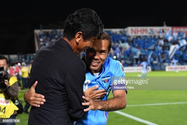 Leandro Domingues of Yokohama FC hugs with Masami Iharacoach of Avispa Fukuoka prior to the JLeague J2 match between Yokohama FC and Avispa Fukuoka...