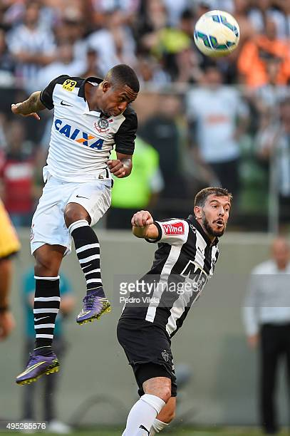 Leandro Donizete of Atletico MG and Malcom of Corinthians battle for the ball during a match between Atletico MG and Corinthians as part of...