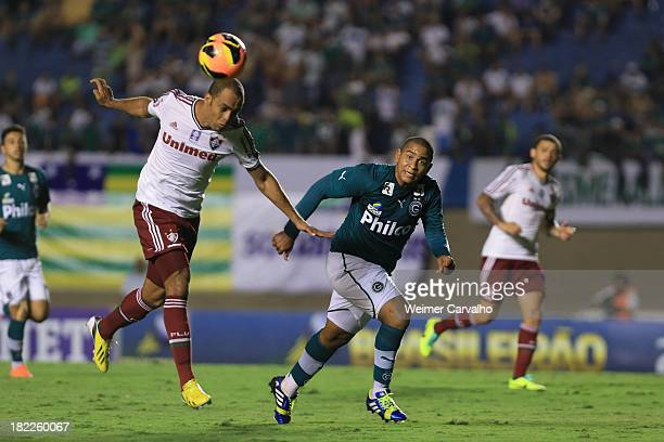 Leandro Euzebio of Fluminense fights for the ball with Walter of Goias during the match between Goias and Fluminense for the Brazilian Series A 2013...