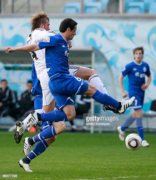 Leandro Fernandez of FC Dinamo Moskva battles for the ball with Sergei Kornilenko of FC Tom Tomsk during the Russian Football League Championship...