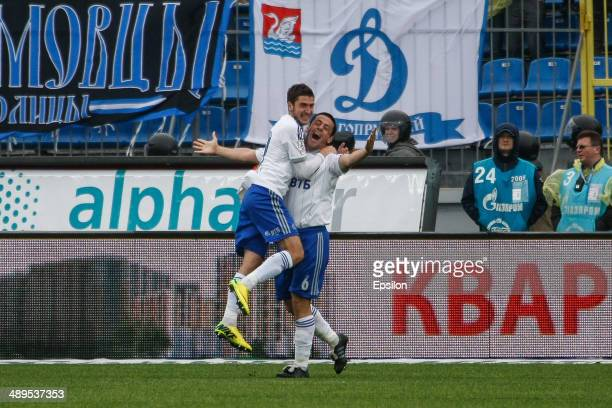 Leandro Fernandez of FC Dynamo Moscow and Aleksei Ionov of FC Dynamo Moscow celebrate a goal during the Russian Football League Championship match...