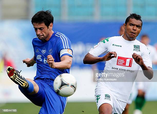 Leandro Fernandez of FC Dynamo Moscow is challenged by Wanderson of FC Krasnodar during the Russian Premier League match between FC Dynamo Moscow and...