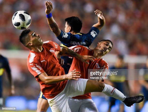 Leandro Fernandez of Independiente fights for the ball with Walter Bou of Boca Juniors during a match between Independiente and Boca Juniors as part...