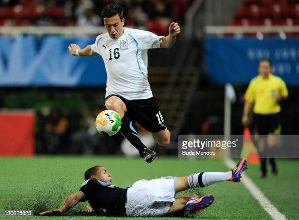 Leandro Gonzalez, of Argentina, struggles for the ball with Mathias Abero, of Uruguay, during a semifinal match as part of the XVI Pan American Games...