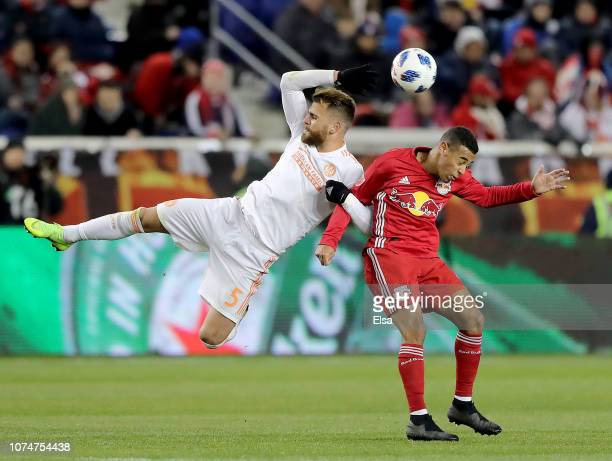 Leandro Gonzalez of Atlanta United FC and Tyler Adams of New York Red Bulls go for the ball during the Eastern Conference Finals Leg 2 match at Red...