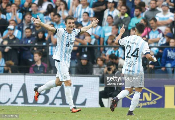 Leandro Gonzalez of Atletico de Tucuman celebrates with teammates after scoring the second goal of his team during a match between Racing and...