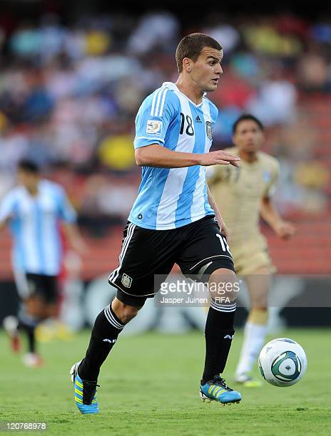 Leandro Gonzalez Pirez of Argentina runs with the ball during the FIFA U20 World Cup Colombia 2011 round of 16 match between Argentina and Egypt at...