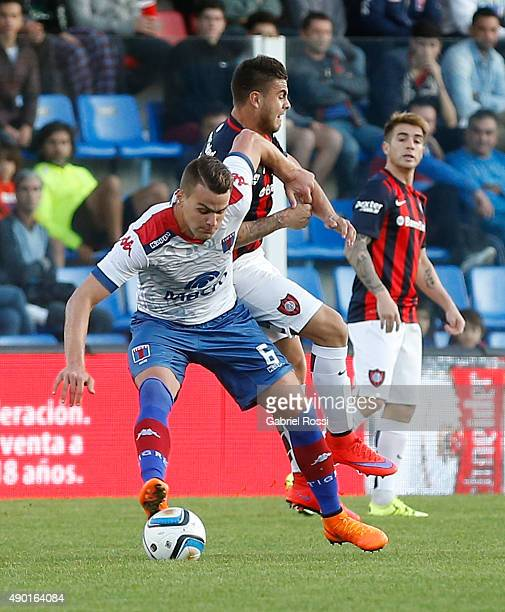 Leandro Gonzalez Pirez of Tigre fights for the ball with Hector Villalba of San Lorenzo during a match between Tigre and San Lorenzo as part of round...