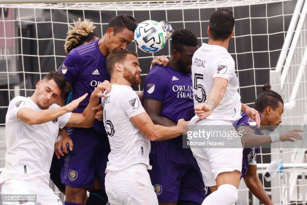 Leandro González Pirez of Inter Miami CF battles for a header with Daryl Dike of Orlando City SC during the first half at Inter Miami CF Stadium on...